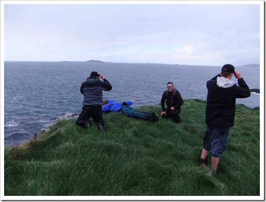 Youth group near cliff on Isle of Staffa