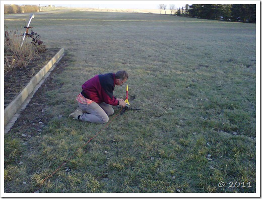 Man lines up and configures model rocket to fire